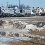 The parking lots are full of RVs, trailers and trucks.